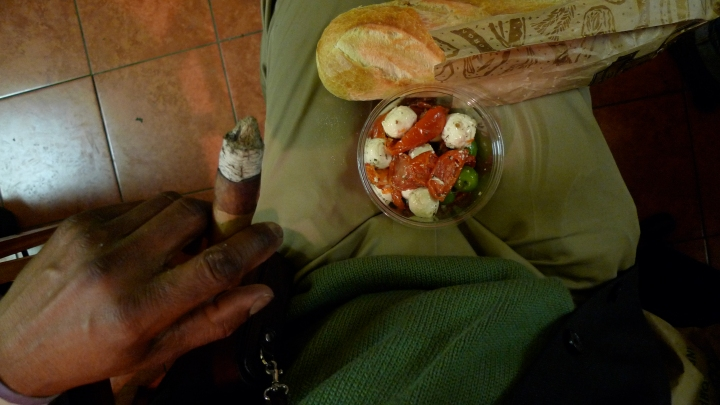 A complex meal: Olives, Mozzarella, Tomatoes, and tobacco leaves rolled into a Maduro. New York City Fine Cigars, New York