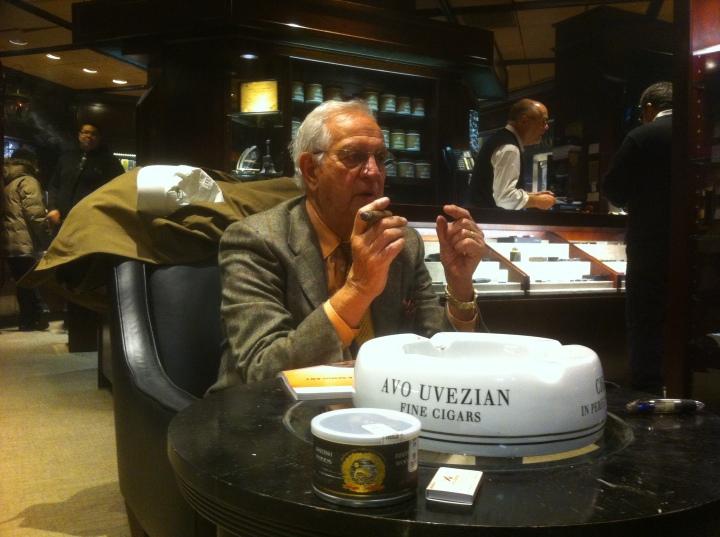 Gentleman smoking a cigar at De La Concha Tobacconist / New York, NY / iPhone 4
