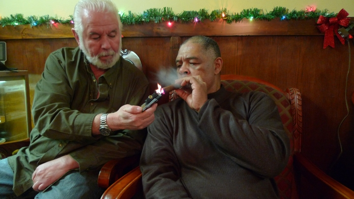 John gives Fire to Renaldo Snipes / NYC Fine Cigars, New York, NY / Leica D-Lux 4