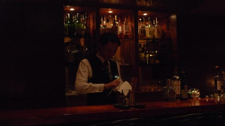 Bartender carving ice into proper shape for cocktails / Le Connoisseur Cigar Bar, Roppongi, Tokyo, Japan / Leica D-Lux 4