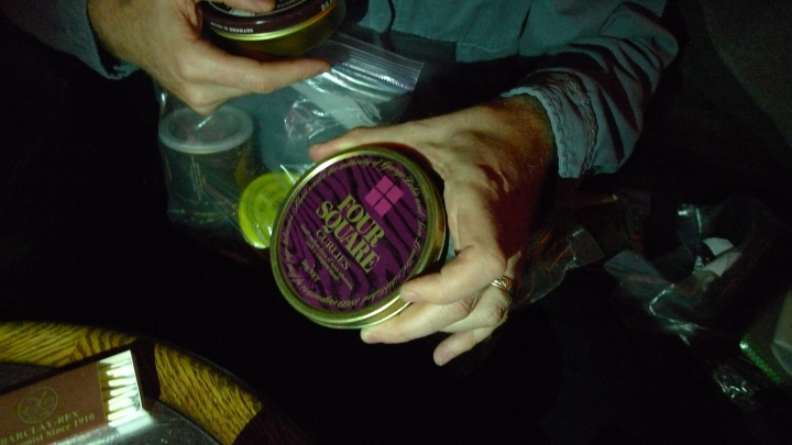 Inspecting old tins with pipe tobacco mixtures at the New York Pipe Club meeting / Soho Cigar Bar, New York, NY / Leica D-Lux 4