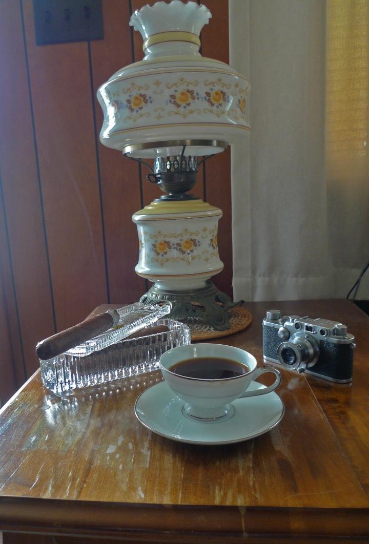 Leica iiiC, Princess House lead crystal ashtray, coffee in Japanese Mikasa china, Double Corona from Martinez Handmade Cigars, New York / Leica D-Lux 4 / Photo: Sila Blume